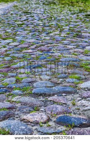 Closeup of Old Ancient Belatussian Pavement Made of Paving Stones. Originally Was Founded in the Beginning of 20 Century. Located in Braslav City in Belarus. Vertical Shot