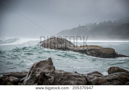 Swell rolls into a cove on the Oregon Coast during a winter storm.