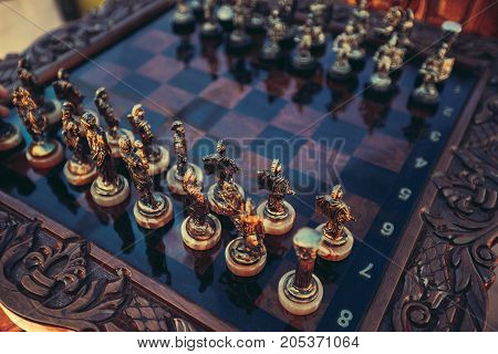 Expensive high quality chessboard with figures close-up