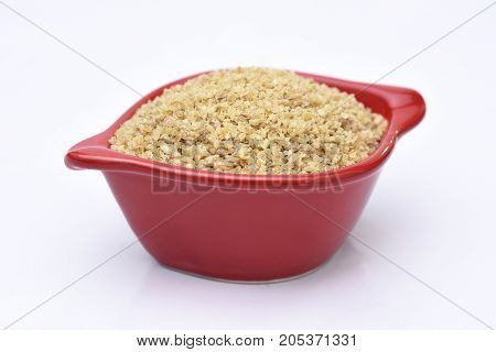 a bowl of wheat and white background