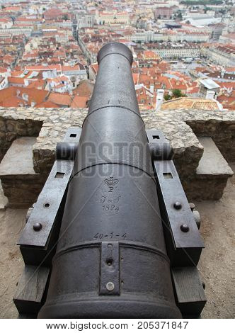 View from atop a historic cannon in Lisbon - Lisboa. Jardim Jъlio de Castilho. Castle of St George Lisbon is the captial city of Portugal poster