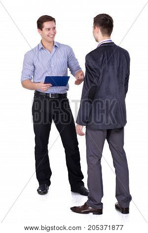 Full length portrait of two businessmen standing together.