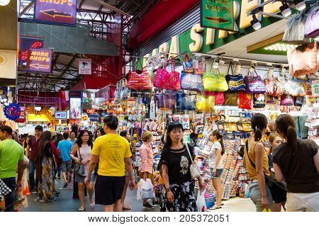 SINGAPORE - SEPTEMBER 7 2017: Shoppers at the famous Bugis Street Market a bargain place renowned for cheap food; clothing souvenirs electronics houseware and cosmetics.