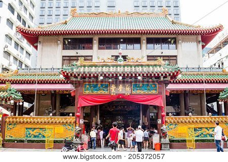 SINGAPORE - SEPTEMBER 7 2017: Worshippers flock to the historical Kwan Im Thong Hood Cho Temple on Waterloo Street during the Hungry Ghost Festival. Since 1884 this Chinese Goddess of Mercy temple has attracted devotees to worship from around the world.
