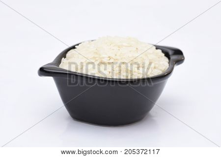 a bowl of healty foods rices and white background