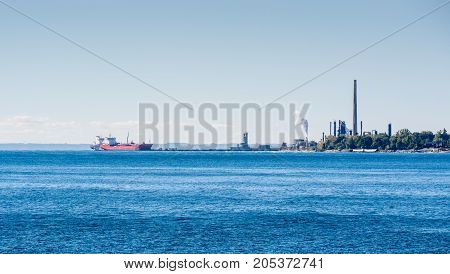 MISSISSAUGA, CANADA - OCTOBER 10 2016: Tanker ships are docked at the Suncor Energy lubricants plant on the northern shore of Lake Ontario.