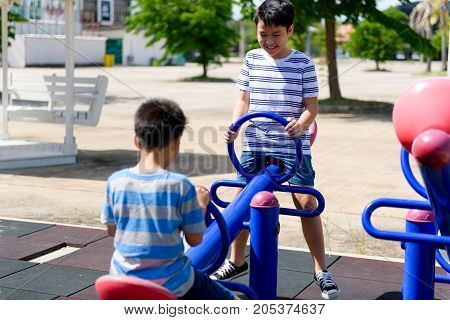 Young Asian Boy Play At The Balance Bar