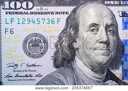 Close Up Of Benjamin Franklin Face On Us Dollar