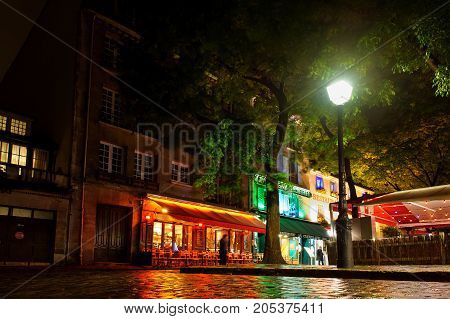 PARIS, FRANCE - 12th of OCTOBER 2012: Cafe on square in Montmartre by night. October 12th, 2012. Paris, France.