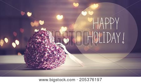 Happy Holiday message with a pink heart with heart shaped lights