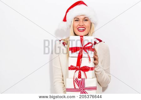 Happy young woman holding a stack of gift boxes