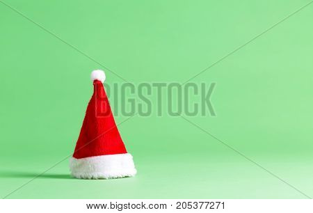 Santa hat on a bright green background