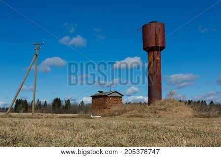 Old rusty water tower in autumn. horizontal shot