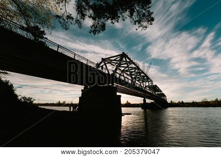 Road bridge Ust-Luga, Kingisepp District, Russia. silhouette at sunset