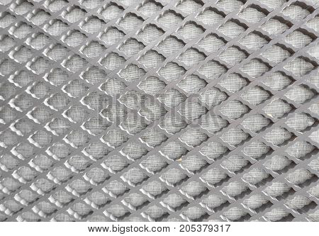 Background Pattern Horizontal Texture of Metallic Gray Perforated Grid with Copy Space for Text Decorated.