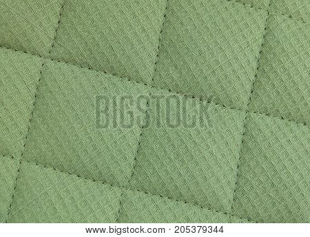 Background Pattern Closed up of Abstract Texture of Green Fabric Sofa or Upholstery.