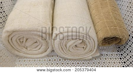 Hygiene Concept Rolled Up White and Brown Terry or Cotton Bath Towels Used for Drying or Wiping A Body.