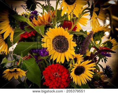 A fall bouquet of flowers gives of an autumn feel