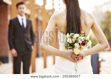 asian loving bride and groom at wedding day.