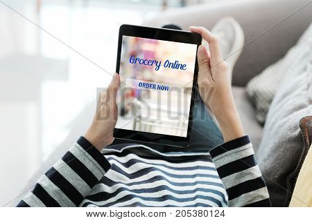Woman hand using tablet with grocery shopping online device on screen background business and technology digital marketing lifestyle concept