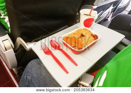Simple In-flight Meal Of Rice, Meat, Coffee In Disposable Utensils