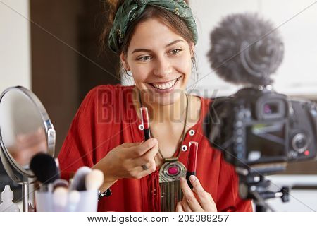 Female Preparing Video Review Of Cosmetic Product Where She Talks About Their Benefits Trying To Per