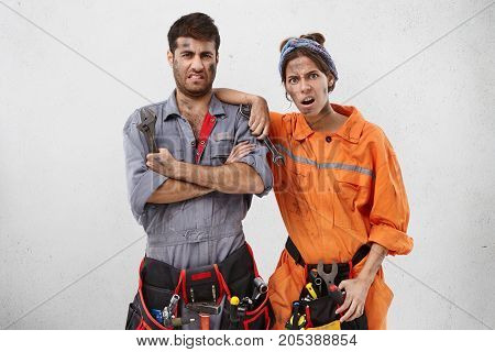 Disappointed Caucasian Maintenance Workers, Have Much Renovation Work, Being Exhausted. Talented Bui