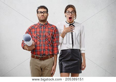 Creative Design Workers: Funny Man Wears Spectacles, Checkered Shirt, Holds Drawings And Elegant You