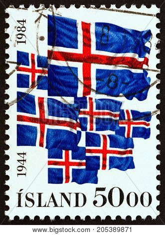 ICELAND - CIRCA 1984: A stamp printed in Iceland issued for the The 40th anniversary of Iceland Republic shows Icelandic Flags, circa 1984.