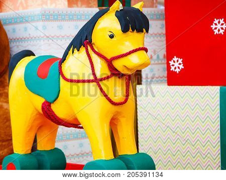 A giant wooden rocking horse Christmas decoration.