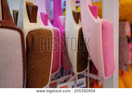 Foot brush into shelves. Colorful of foot brush.