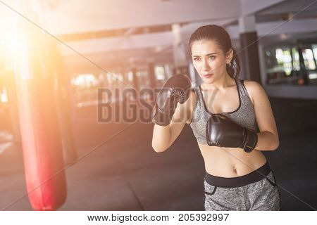 Asian Young Woman Doing Exercise With Thai Boxing (muay Thai) Equipment In Gym. Health And Fitness C