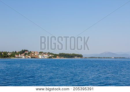 Landscape of open sea with beautiful settlement over blue sea