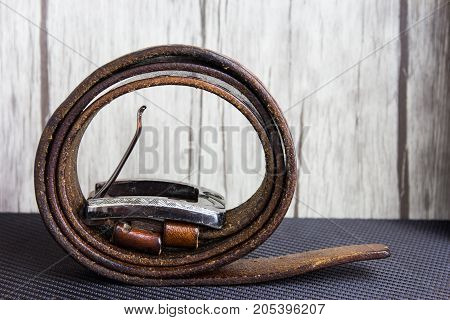 Close up of brown leather belt on table