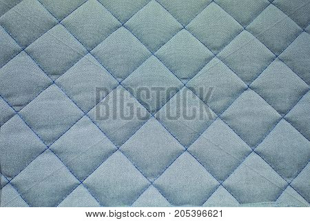 Close up textures of blue mattress. Background and texture of fabric.
