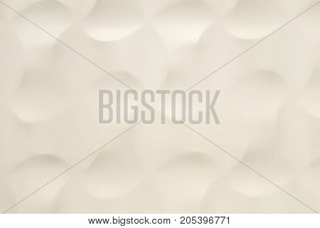 The dent on white background. White wall and round dented. Background and texture of white wall.