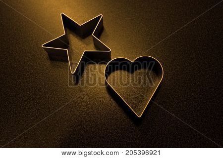 Cookie cutter on black background. Heart and star form cookie cutter.