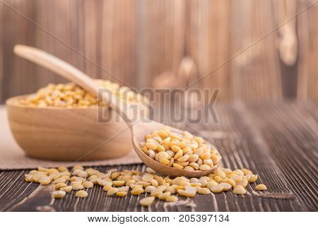 Peeled Yellow Soybean On Brown Wooden Board