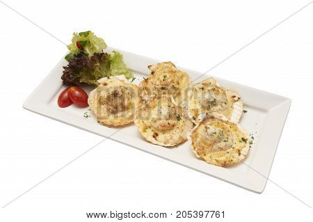 Isolated of baked scallop with cheese in white plate. Clipping path and white background.