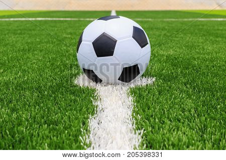 Soccer Ball On Artificial Bright And Dark Green Grass At Public Outdoor Football Or Futsal Stadium