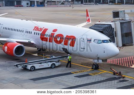 Bangkok Thailand - 14 September 2017 - Thai Lion Air aircraft waits for passengers while technician checking on the luggage belt at Don Muang International Airport Bangkok Thailand on September 14 2017