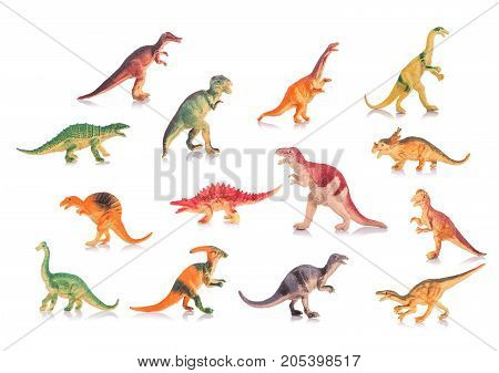Collection Of Silicone Or Plastic Toy Dinosaurs. Studio Shot And On White