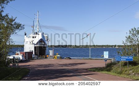 SNACKO, ALAND ON JUNE 28. View of the ship, ferry Odin moored by the Snacko harbor on June 28, 2017 in Snacko, Aland, Finland. Berth, quay and sign this side. Summer. Editorial use.