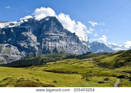 View To Grosse Scheidegg In The Grindelwald Valley, Swiss Alps, With Mountain Peak Visible In Clouds