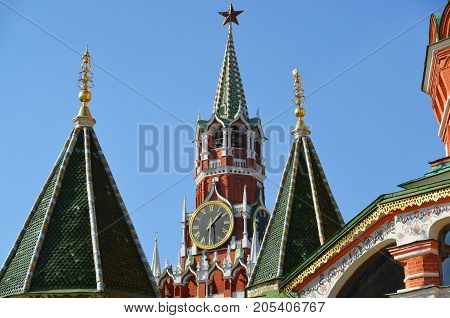 Spassky tower and a domes of St. Basil's Cathedral in Moscow, Russia.