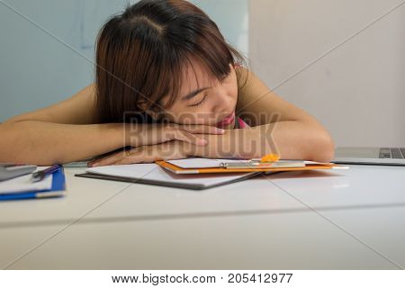 Drowsy girl falling asleep at office in working time