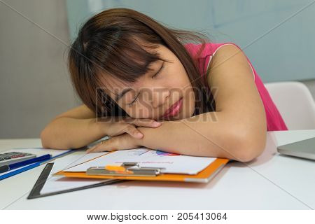 Asian office girl take a nap after lunch