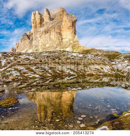 Water reflection of Cima Piccola (Tre Cime di Lavaredo) in Dolomites - South Tirol