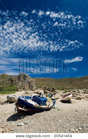 Rusty Old Boat On The Shore In Greece Island Crete