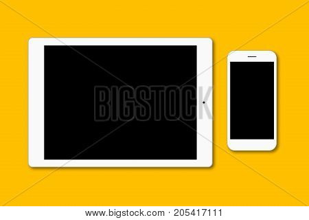 Modern Smart Phone And Digital Tablet Isolated Over Yellow Surface. Contemporary Gadgets With Blank